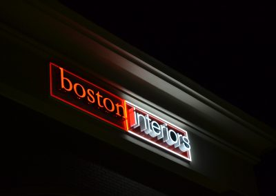 boston interiors sign at night