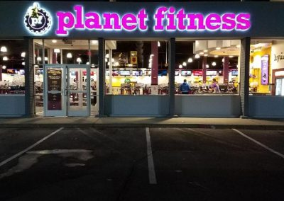 planet fitness sign at night